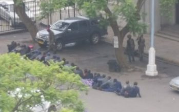 See How Zimbabwean Soldiers Paraded Their Police Officers Like Thieves